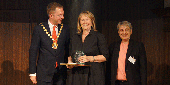 Lisa Milton presenting an award to Jane Buchanan and the Lord Mayor